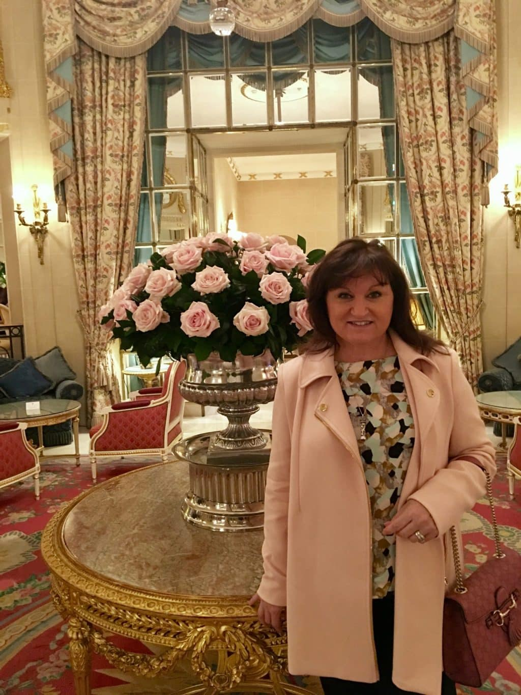 Valentines Week in the Ritz London, lady with pink coat