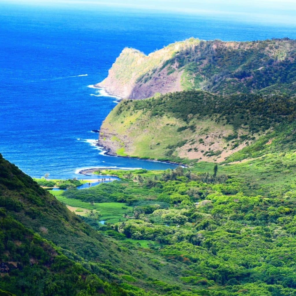 Helicopter Tour Hovering over Moloka'i Hawaii