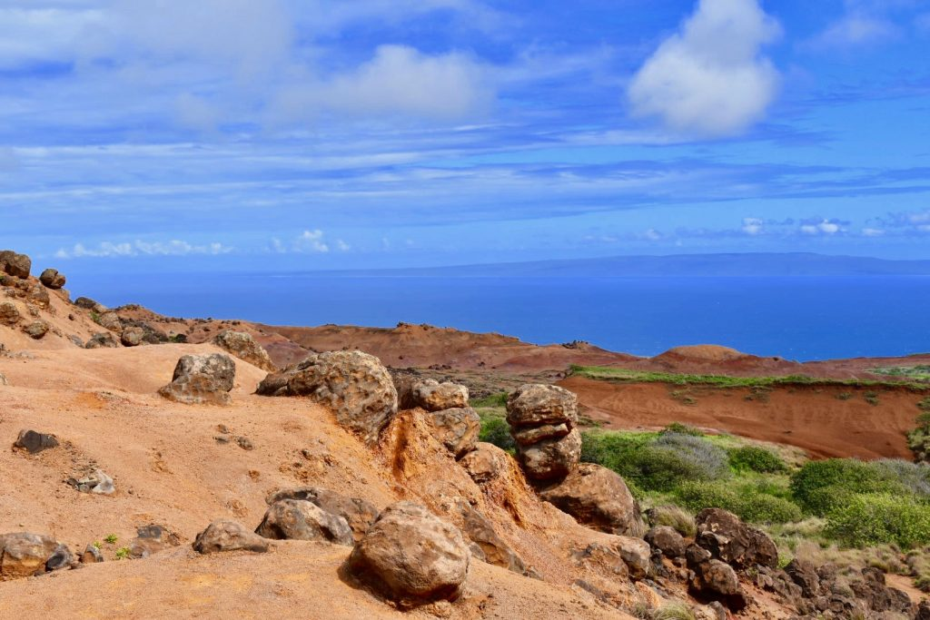 Garden of the Gods with red rocks and blue ocean in background- Lanai Hawaii