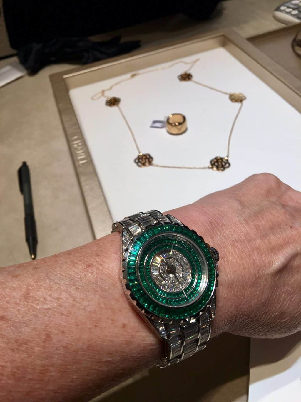 Chanel Paris. Hand is shaking with emerald watch!