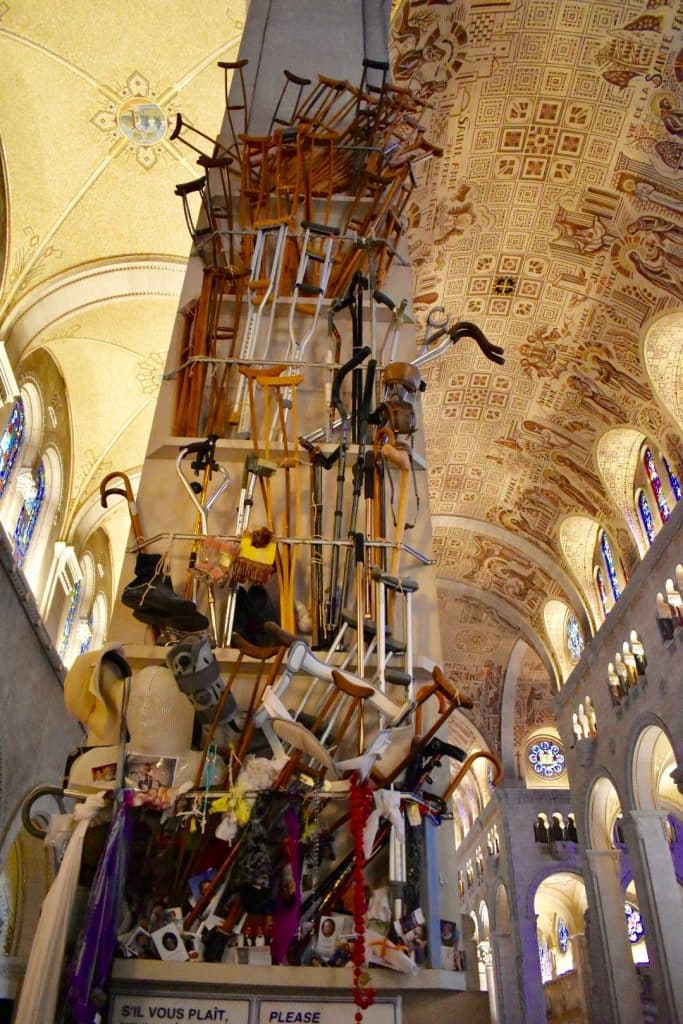 Crutches hanging from column at the Shrine of Sainte-Anne-de-Beaupré