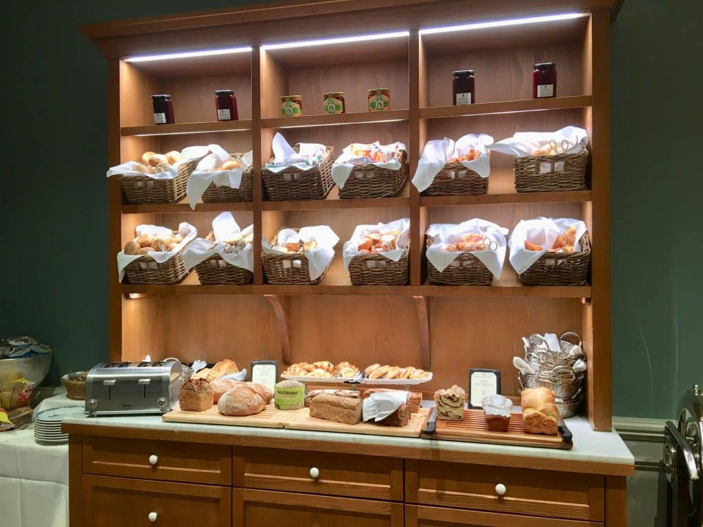 Bread and roll cupboard at breakfast buffet Brenners Park-Hotel & Spa