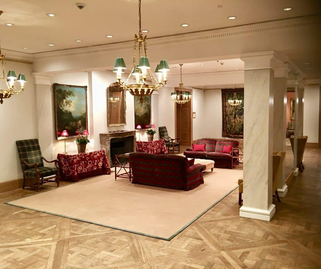 Inside sitting lobby area at Brenners Park-Hotel & Spa; couches, chairs and fireplace