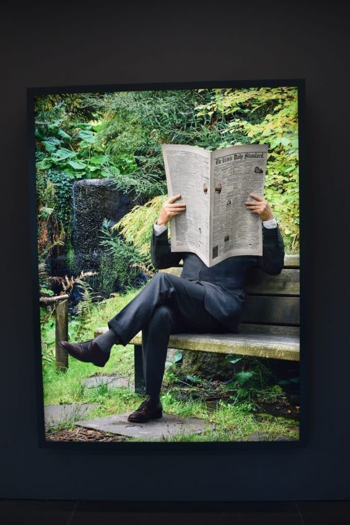 Man reading newspaper Rodney Graham light box