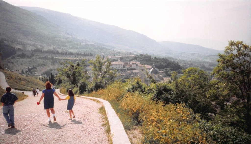Family walking down the road that led from the castle