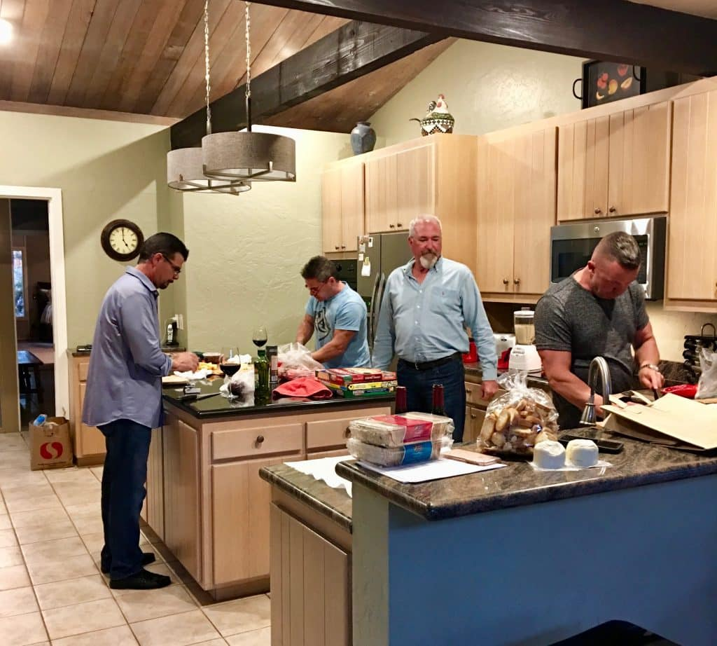 four men cooking in the rented home kitchen in Sonoma California