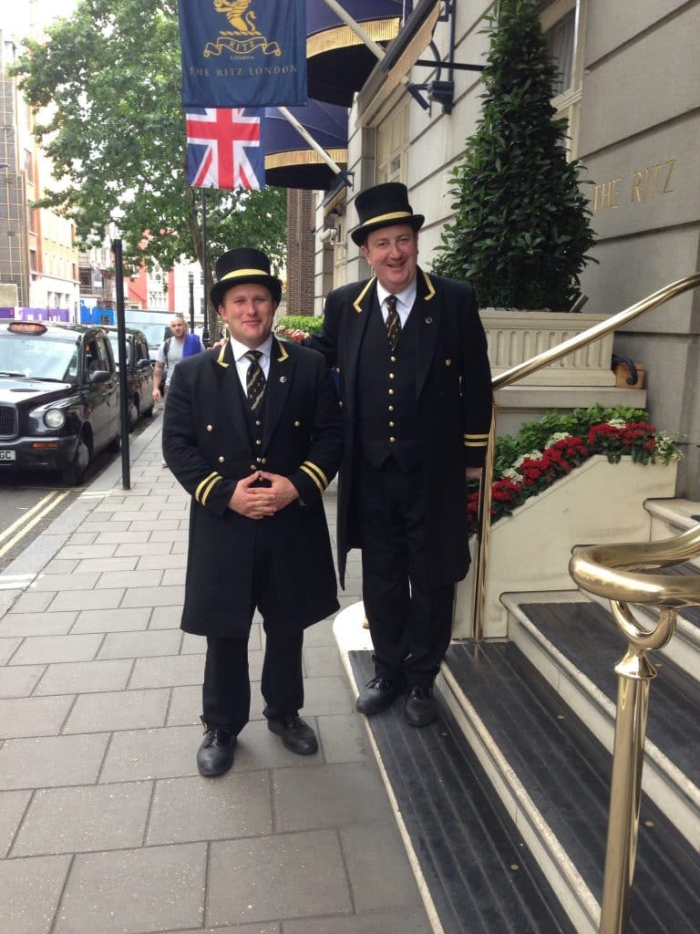 Two Doormen standing outside at the Ritz London were wonderful and charming!