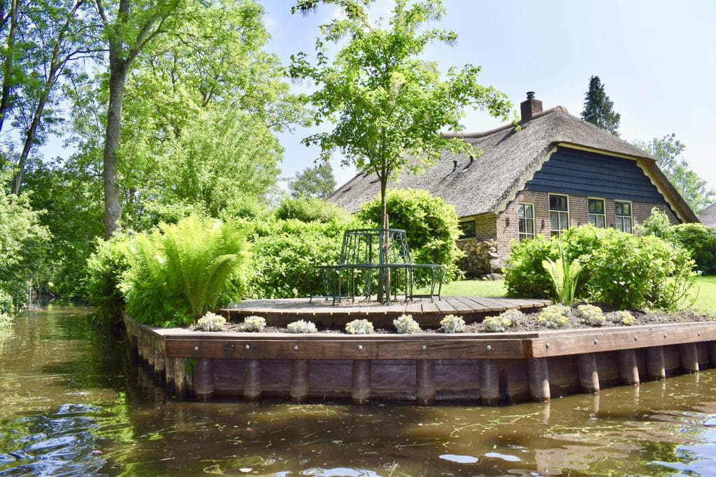 Thatched roof on corner of canal in Giethoorn Netherlands