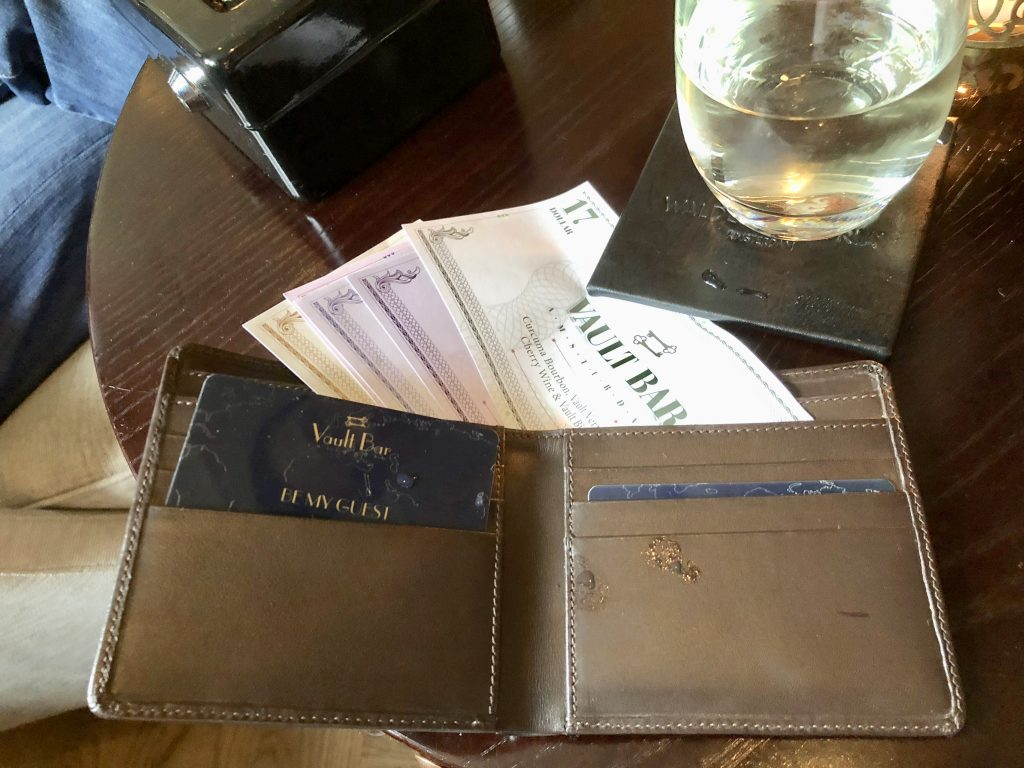 Menu in a wallet using bank notes at The Vault Bar at the Waldorf Astoria Amsterdam. Menu using bank notes in wallet