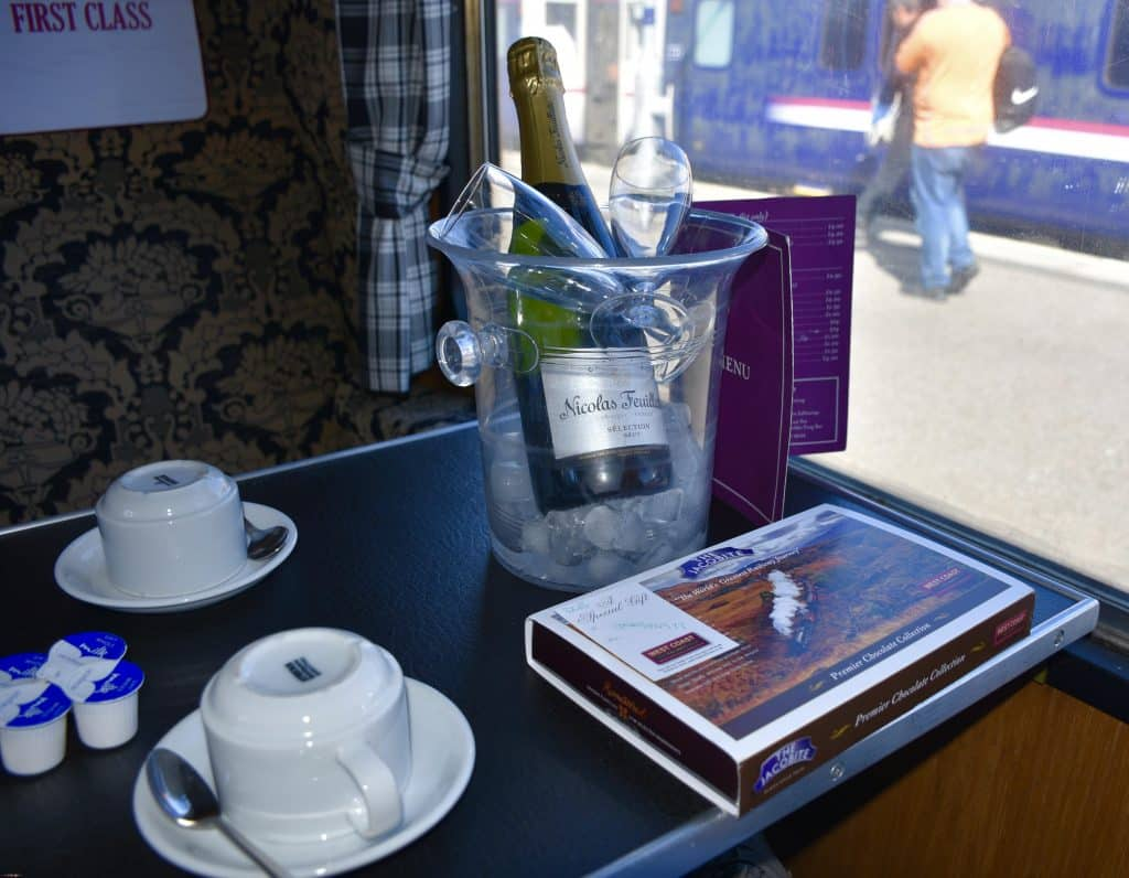 chocolates and champagne on table of Jacobite train