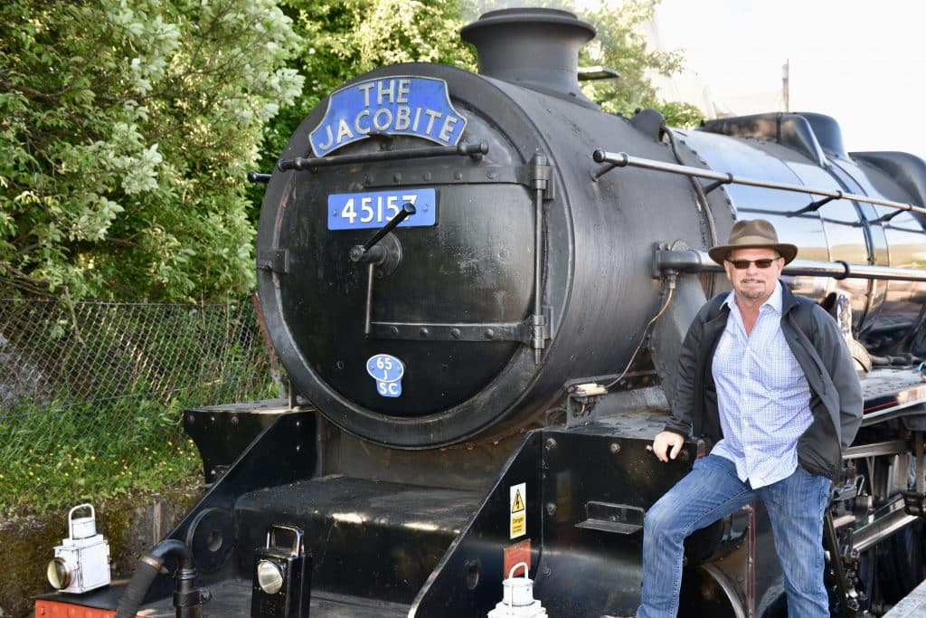 Kevin standing next to the Jacobite train