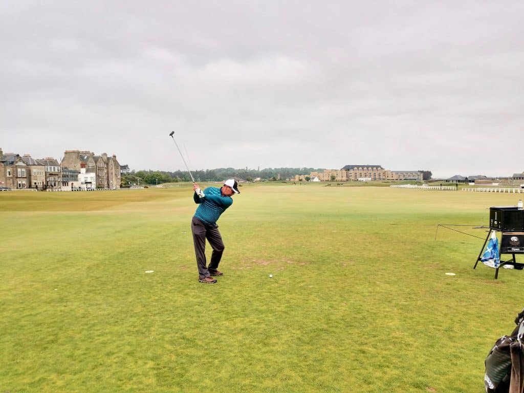 Swinging club on the old course at St. Andrews